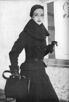 Model in double-breasted wool coat with large collar by Anthony Blotta, Vogue, October 1, 1951