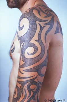 Tribal Tattoo...something every man should get...they are the ultimate sexy, male tattoo ;)