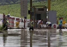 China rains kill nearly 100, 37 in Beijing #poisonedweather #climate #flood 7/23/12 Andy Wong/AP