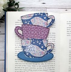 This tea cup stack bookmark is a unique gift idea for the book & tea lover! Size x Made from cotton fabrics and wool felt Interfaced for durability Backed in a coordinating wool felt Sponge Clean Our bookmarks are made using free moti. Free Motion Embroidery, Machine Embroidery, Etsy Handmade, Handmade Gifts, Handmade Baby, Tea Coaster, Fabric Coasters, Matching Gifts, All Things Purple