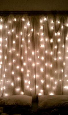 Bedroom lighting - string lights behind   sheer curtains. Love it!!