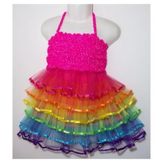 Rainbows Tutu with a crochet top made from yarn that glows with light.  A perfect party outfit.  The skirts mostly contain the same colours but may be in a different order.  The crochet tops come in Hot Pink Lime Green Yellow and Orange to match the colours in the skirt. These yarns have a silver fleck which glows with light.  Yarns without the fleck are available in all colours in the skirt.  Comes in sizes 1/2 and 2/3. Limited stock so get in early.  Tops will be made to order.  DM to…