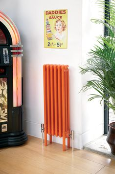 In our world radiators are there to keep us warm and make a statement. This is a three column deep radiator, which is six sections long,… Electric Radiators, Cast Iron Radiators, Decor Interior Design, Interior Decorating, Painted Radiator, Column Radiators, Steel Columns, Designer Radiator, Orange Interior