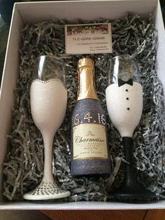Bride and groom gift set glitter champagne flute glasses with bottle of champagne   £30   www.facebook.com/tlcglitterglasses