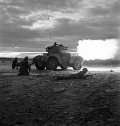 A Daimler armoured car opens fire in the gloom of early morning at the start of the battle for Tripoli 18 January 1943 Army Vehicles, Armored Vehicles, Armored Car, Gi Joe, Ww2 Pictures, Ww2 Photos, Historical Pictures, Afrika Korps, Military Armor