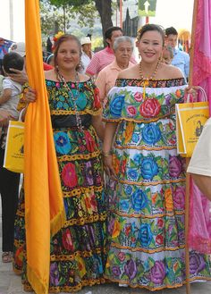 Two Chiapanecas Mexico    Two women wear slightly different styles of the lovely and popular Chiapaneca costume. Feast of San Antonio Abad in Chiapa de Corzo, Chiapas Mexico