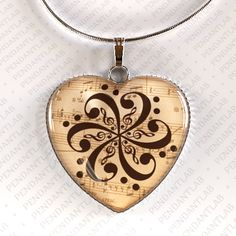 Hey, I found this really awesome Etsy listing at https://www.etsy.com/listing/129264371/bass-clef-flower-pendant-bass-clef-bass