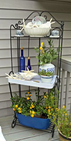 Upstairs Downstairs: Blue and White Outdoor Baker's Rack - Modern Bakers Rack Decorating, Porch Decorating, Outside Patio, Back Patio, Outdoor Landscaping, Outdoor Gardens, Outdoor Decor, Outdoor Plants, Outdoor Bakers Rack