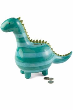 This stripped dino-bankwill make a perfect gift.   Ceramic Dinosaur Bank by Mud Pie. Home & Gifts - Gifts - Gifts by Occasion - Just Because Home & Gifts - Gifts - Odds & Ends Home & Gifts - Gifts - Gifts by Occasion - Baby & Kids West Virginia