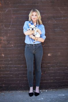 Kristi Mikesky, Fashion and Beauty Editor - Swap out your baby-blue skinny jeans for a dark gray pair, a fresh update on the tried-and-true style. Teamed with a lived-in, chambray button-down and d'Orsay heels, the look exudes simple sophistication—no bells and whistles necessary (unless of course you'd care to accessorize with an incredibly cute puppy).