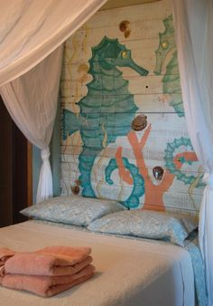 re purposed fence panel, mural art, head board, sea horses, coral, turquoise, sea green, bedroom, sail cloth, cottage style, shabby chic