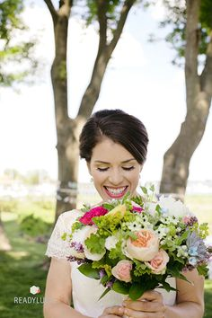 Laid-Back Maryland Wedding Inn at Perry Cabin, Bride with Colorful Bouquet | Brides.com