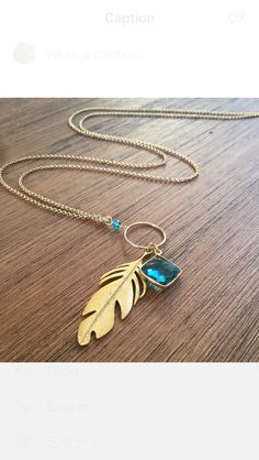 $38 Tres designs gold feather necklace with seablue gemstone