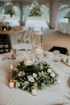 Green and white wreath and candle centerpiece | Image by Lauren Louise Photography