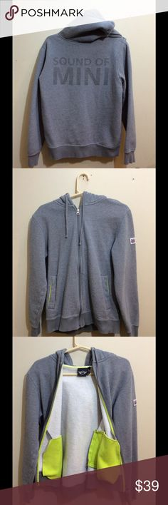 "MINI Cooper Gray Hoodie Sweatshirt Small Medium Make this yours!   Sound of Mini gray hoodie with a full zip w/ neon yellow detailing on the pockets .  Goes for $70 on Amazon.  The Measurements: Tag size says Medium but measures much more like a Men's Small. Chest: 40"" Length: 25""  Condition: No signs of wear. mini cooper Shirts Sweatshirts & Hoodies"