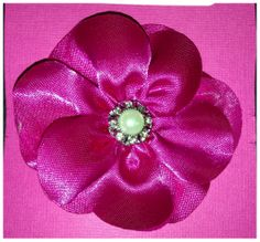 bright pink flower clip with jeweled embellishment  www.facebook.com/GabbyAbbyBoutique