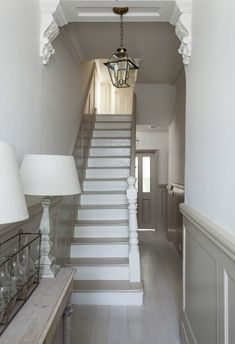 Put moulding along hall and up stairs?