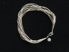 A personal favorite from my Etsy shop https://www.etsy.com/listing/584099231/sterling-silver-multi-strand-bracelet