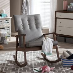 $291- Featuring Scandinavian style with modern aesthetic, the Nikanor rocking chair features upholstered high back cushioned seat with button tufting design. The rocking base of the chair is constructed of solid rubberwood in dark walnut finishing for a truly retro feel. The sculpted armrests provide strong support for extra comfort after a long day. This piece, looks smart, modern, but comfortable can be a good rocking chair for nursery during middle of the night feedings and yet a pretty…