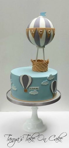 Hot air balloon baby shower cake. Grey and blue cake, clouds, baby banner…