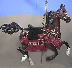 """Kismet""--A one-of-a-kind, hand-carved Arabian horse in Native costume"