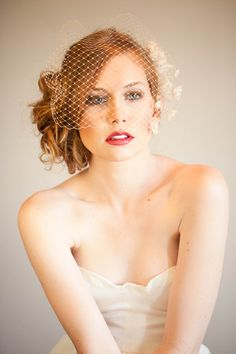 Like: birdcage veil with hair up to the side  Dislike: hair looks a little messy
