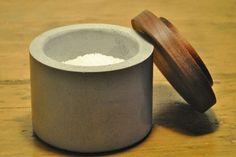 Hey, I found this really awesome Etsy listing at http://www.etsy.com/listing/155760845/concrete-salt-cellar-with-black-walnut