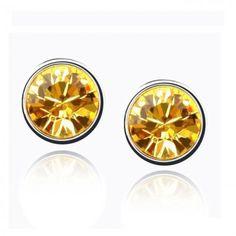 Brincos Pontos de Luz Amarelos - Brincos pequenos com cristal dourado. Tamanho: 0,7cm. Joia com banho de Ouro Branco 18K. Só R$ 29,00!!!