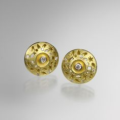 "Barbara Heinrich...A pair of 18k yellow gold ""Milkyway"" studs with two center diamonds = .08cttw and 10 scattered diamonds = .10cttw. Diameter measures 1/2""."