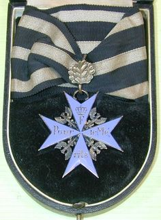 """Rare WWI German Pour Le Mérite """"Blue Max"""" with Oak Leaves Order in the original fancy fitted presentation case.   There were less than two dozen recipients of this extremely rare order.  They included:   General Field Marshal von Hindenburg; General Field Marshal von Mackensen;  General von Beseler;  General von Emmich;  General von Falkenhayn; General von der Marwitz;  General von Linsingen;  Lieutenant General von Ludendorff; and Albrecht, the Duke of Württemberg."""