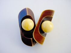 "PAIR OF ART DECO DESIGNED VINTAGE SEMI-BUFFED CELLULOID BUTTONS! BUTTONS MEASURE 1 1/2"" HIGH Sold for $16 in Oct. 2013"