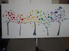 Could pre-paint tree trunks and branches on large canvases.  Then kids could add fingerprints and handprints for the leaves.  Auction or raffle the finished pieces.  Photograph them first to create prints for resale.