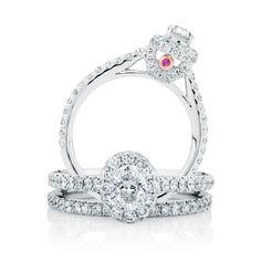 The Michael Hill Designer Bridal Collection oval cut center diamond Allegro bridal set.