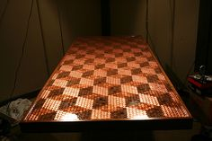 5,218 pennies later…Penny table top! http://www.newslinq.com/table-of-pennies/