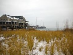 Snow on the ground at Jennette's Pier in Nags Head, North Carolina :: January 31, 2014 :: #SnOBX