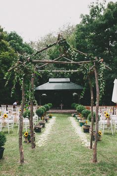 wooden rustic archway for the wedding aisle