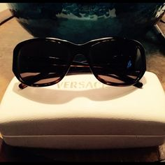 Versace sunglasses Gorgeous, authentic, Versace sunglasses. Includes case. Dark lenses and tortoise frames.  Like new, no signs of wear.. Versace Accessories Sunglasses