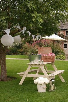 Welcome: Picnic table holds galvanized tubs, cards, gifts, signs