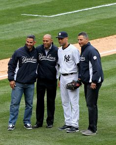 Former New York Yankees Jorge Posada, Mariano Rivera and Andy Pettite pose with Derek Jeter #2 before the home opener between the New York ...