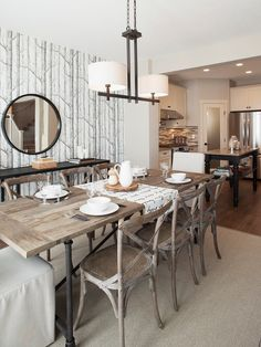 Sabal Homes: Gorgeous dining room with Cole & Sons Woods Wallpaper framing black convex mirror over ...