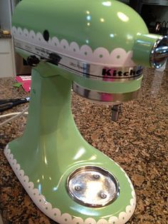 DIY redone KitchenAide Mixer!!! I did this, check out how I made it on my sister's blog.