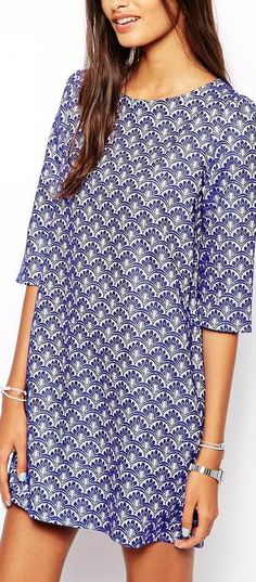 Dear stylist: I like this print, think it would be cute as a loose fitting top if shorter but I like it as a dress too though I'd see if it looked better belted. I don't think it'd look good on me so loose all the way down