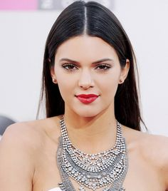 Kendall Jenner's Slick Center Part + Glossy Red Lips