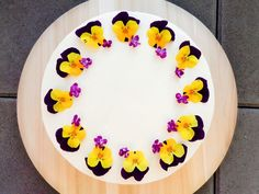 Lemon cake with mascarpone cream and edible flowers- pansy.