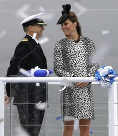 "Kate, the Duchess of Cambridge, formally christened the Royal Princess cruise ship, the newest addition to Princess Cruises' fleet in Southampton. Kate was on hand to name the vessel -- ""I name this ship Royal Princess. May God bless her and all who sail in her"" -- & then broke the ceremonial bottle of champagne on the hull. She was wearing the Dalmatian Print Mac, by Hobbs. - 6/13/2013"