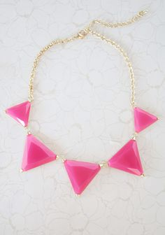 """Geometric Designs Necklace 19.99 at shopruche.com. Add a hint of color to your outfits with this golden hued necklace adorned with faceted pink pendants that shimmer with every movement.19"""" long"""
