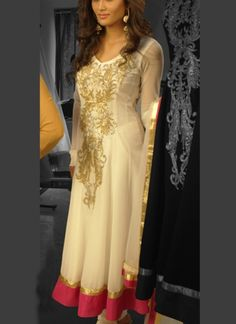 Designer white long churidar suit. Designer suit is build of georgette fabric with heavy stone and zari work on front and back side of Kameez. You will get a matching dupatta as you saw in image. NOTE: Bigger sizes like 46,48,50,52 are available at an additional charge .
