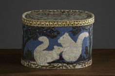 Bandbox with Two Squirrels  Pasteboard box covered with paper, stamped with squirrel woodblock print; lid depicts a cornucopia pattern.  ~ ITEM DETAILS ~ Dimensions: W. 17 ½, Ht. 12, D. 13  Date / Circa: c. 1835  Maker / Origin: New England ~♥~