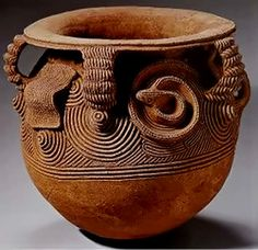 Carved global vessel with everted rim from the Igbo people of Nigeria