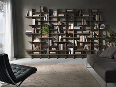 Design: Cesare Arioso Elisabeth, modular library wall with veneered walnut or wood fiber structure, shelves and dividers. Lightweight design and simple lines Wooden Living Room Furniture, Living Room Bookcase, Library Wall, Wall Decor Design, Interior Minimalista, Room Ideas Bedroom, Farmhouse Style Decorating, Minimalist Interior, Apartment Interior